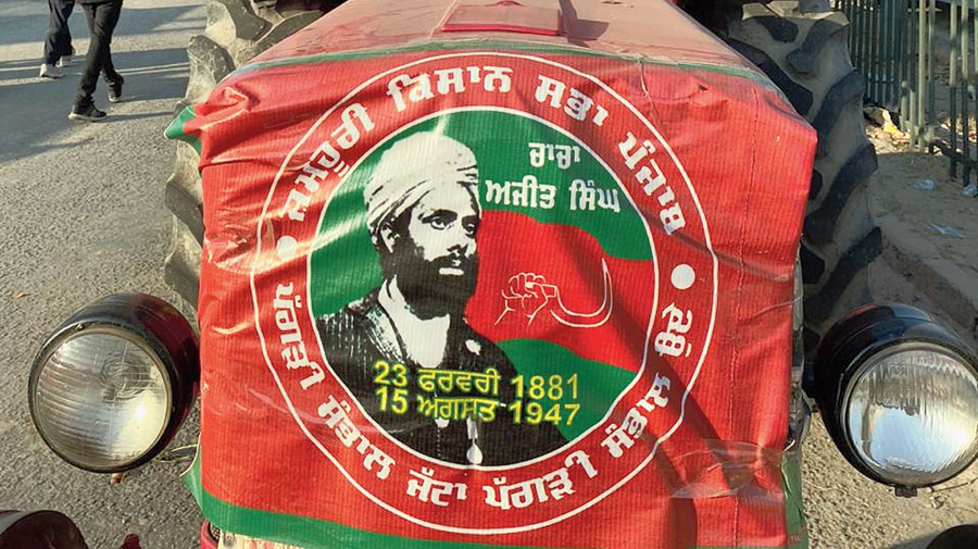 A tractor at the Delhi-Haryana Singhu border with a banner of Punjab's Jamhoori Kisan Sabha featuring Sardar Ajit Singh.