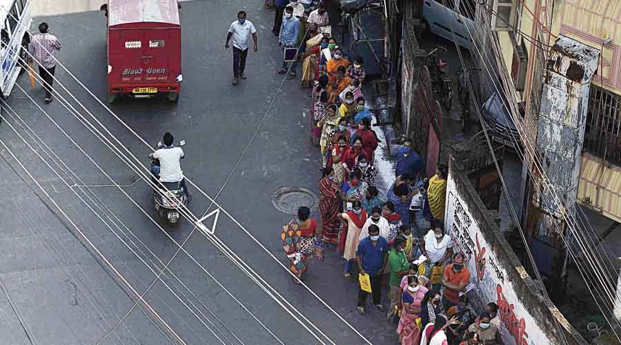 At your door: A long queue in Garfa on Tuesday for the state government's outreach programme, Duare Sarkar (government on doorstep), where officials and elected representatives heard residents' grievances.