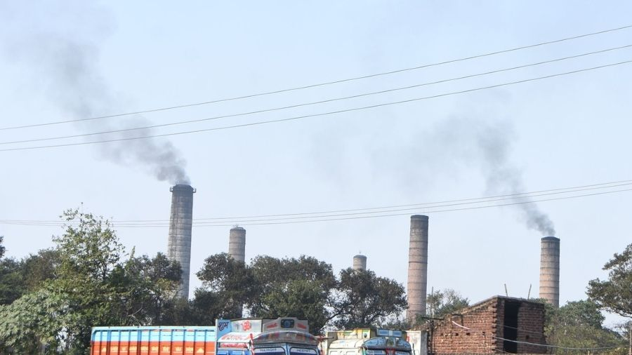 Smoke billows from factory chimneys on GT Road in Dhanbad on Wednesday.