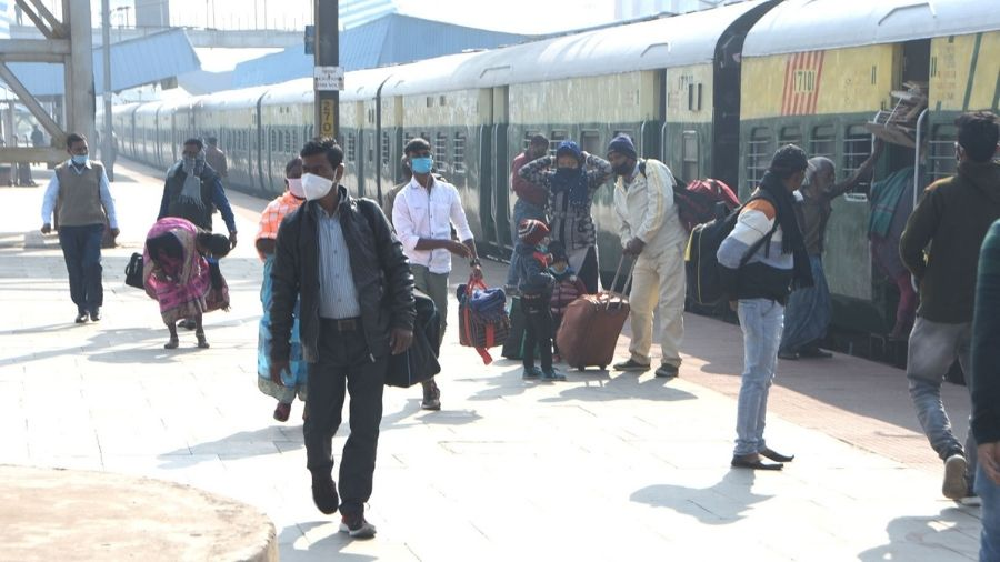 Passengers board and get off from the Dhanbad-Asansol MEMU train on Wednesday at Dhanbad Railway Station.