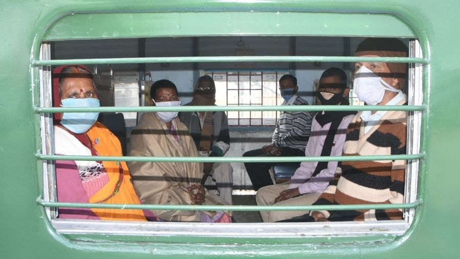Passengers sit inside the Dhanbad-Asansol MEMU train before it departs from the Dhanbad railway Station on Wednesday.
