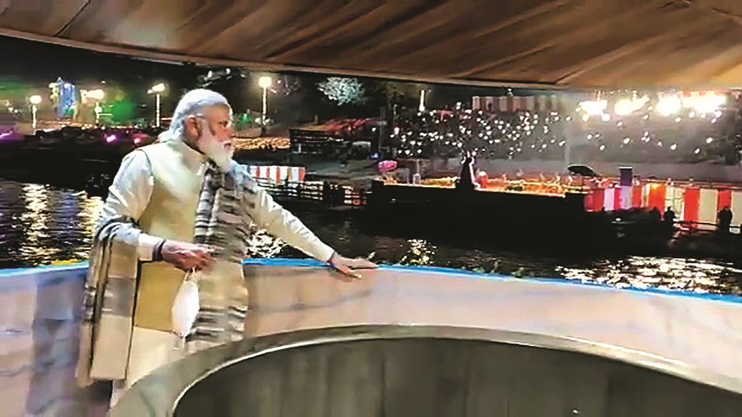 Prime Minister Narendra Modi watches the light and sound show during Dev Deepawali festival, in Varanasi, Monday, Nov. 30, 2020.