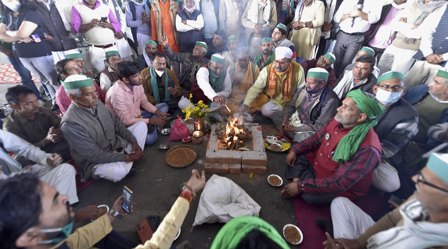 Farmers perform a havan during their ongoing agitation against new farm laws, at Ghazipur Delhi-UP border, in New Delhi on Wednesday, Dec. 2 2020.