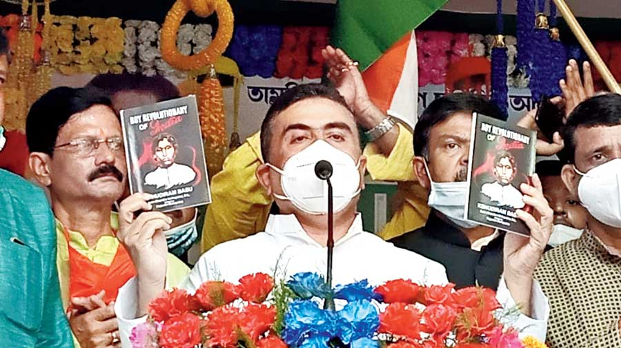 Suvendu Adhikari releases a book to observe the birth anniversary of freedom fighter Khudiram Bose in East Midnapore's Tamluk on Thursday.