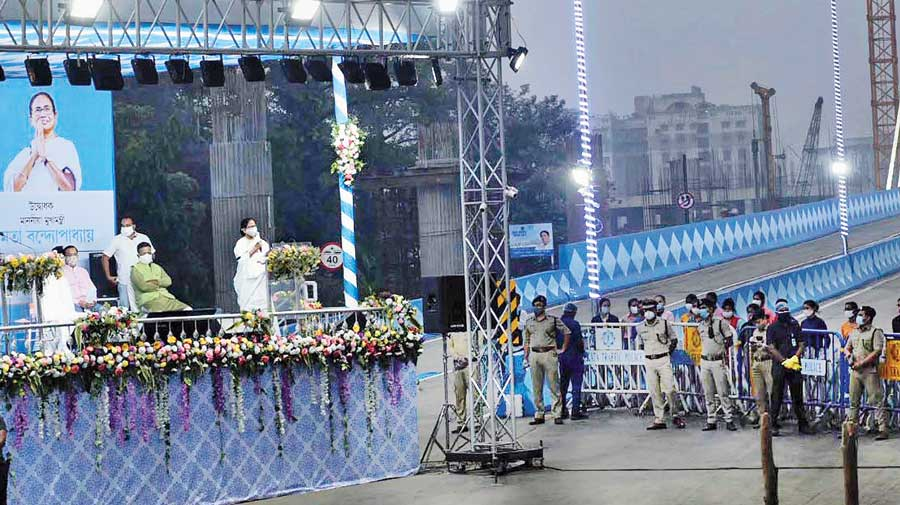 Chief minister Mamata Banerjee speaks at the inauguration of the Majerhat bridge on Thursday evening.