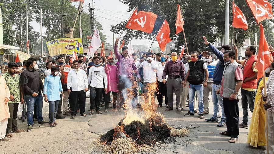 Members of the All India Kisan Sabha, a wing of the CPM, block NH12 near Kalyani on Friday to protest against the farm laws.