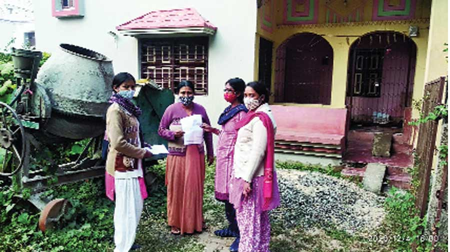 Members of women's self-help groups visit a home to distribute application forms for welfare schemes at a Birbhum village on Friday