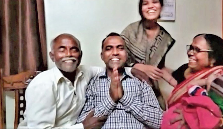 Ranjitsinh Disale (with folded hands) and his family on Thursday.