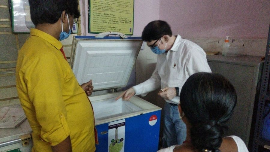 Palamau child health officer Anil Kr. Singh inspects a cold chain box in a district community health centre on Saturday.
