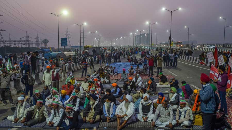 Farmers during their agitation at the New Delhi Delhi-Noida border near Ghazipur on Saturday.