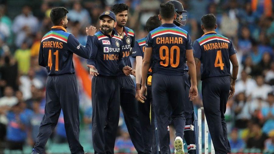 Men in Blue celebrate after Deepak Chahar dismisses Steven Smith at 46 on Sunday, in Sydney.