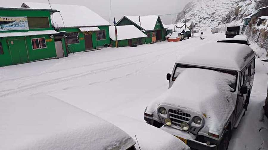An SUV with a heap of snow on the bonnet in East Sikkim