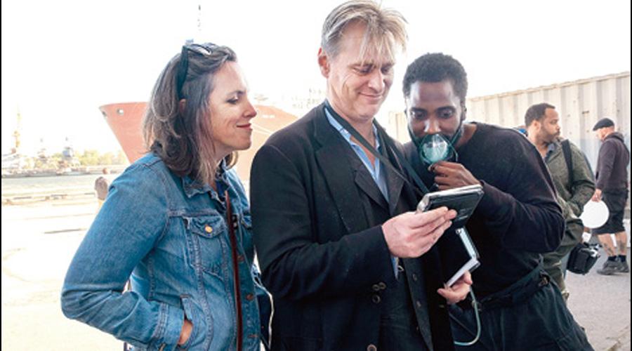 Emma Thomas with Christopher Nolan and John David Washington on the sets of Tenet.