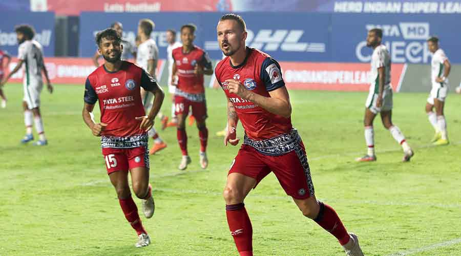 : Nerijus Valskis (right) of Jamshedpur FC celebrates after scoring the first of his two goals against ATK Mohun Bagan at Tilak Maidan in Vasco on Monday.
