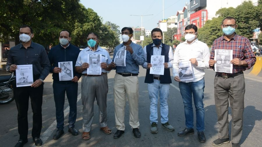 IMA Jharkhand doctors hold posters during their agitation against the Centre's order at the Sakchi roundabout in Jamshedpur, on Tuesday.