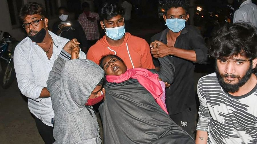 A woman showing symptoms of epilepsy being carried to a hospital in Eluru town on Sunday night.