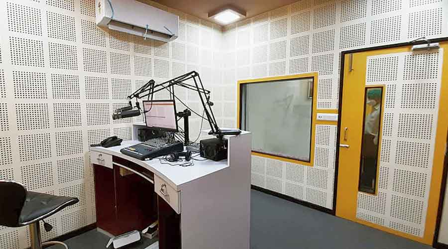 Riding the wave: Inside a recording booth at the studio of Radio New Town on the fourth floor of Nazrul Tirtha.