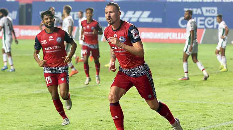 Nerijus Valskis (right) of Jamshedpur FC celebrates after scoring the first of his two goals against ATK Mohun Bagan at Tilak Maidan in Vasco on Monday.