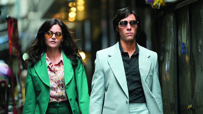 Jenna Coleman as Marie-Andrée Leclerc and Tahar Rahim as Charles Sobhraj in The Serpent.