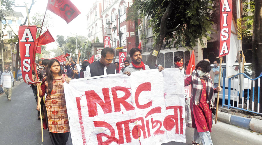 Protesters against NRC, NPR and CAA march through SN Banerjee Road on Friday afternoon.