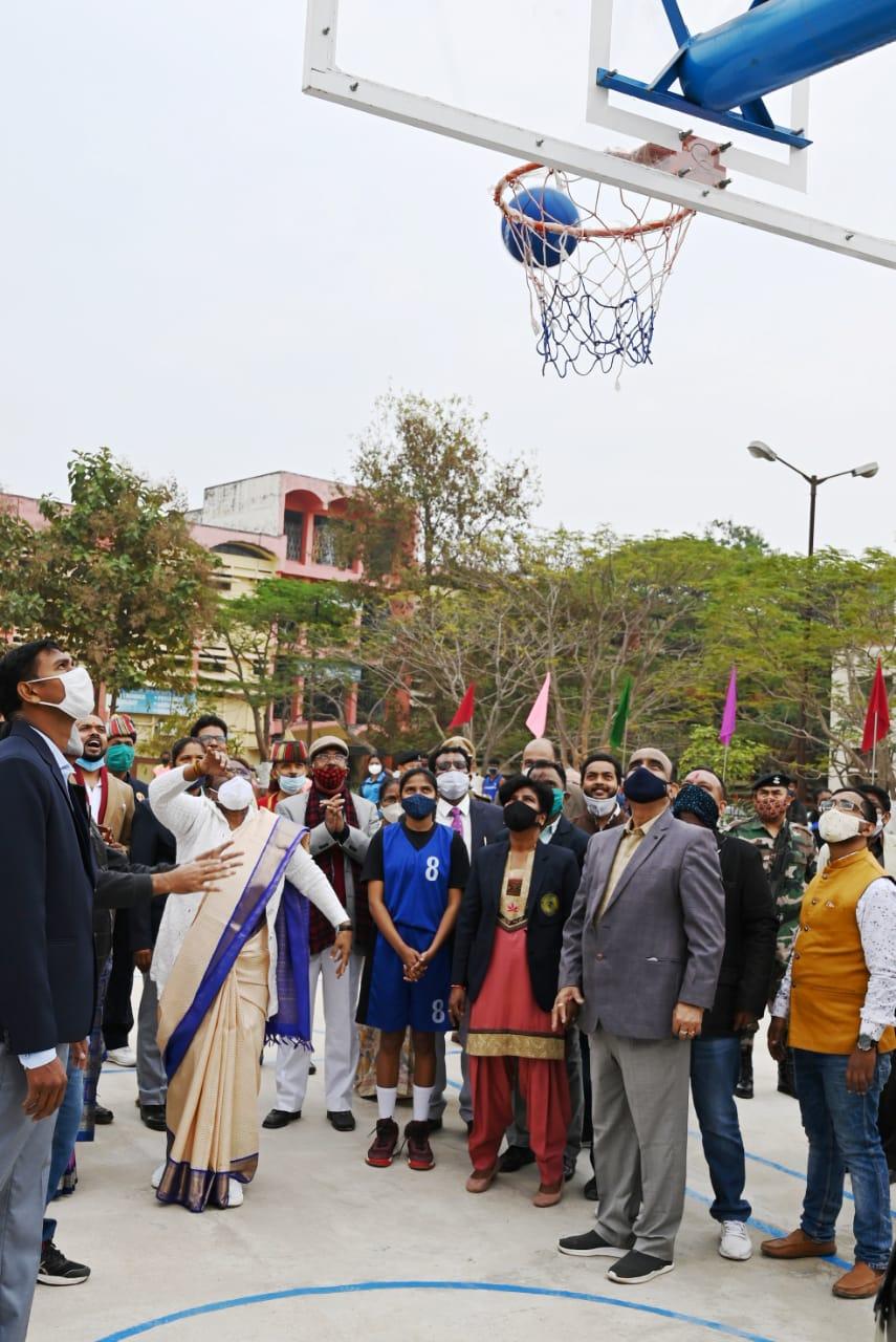 Governor Droupadi Murmu tries her hand at basketball after inaugurating a new court at the Ranchi University campus at Morabadi on Sunday.