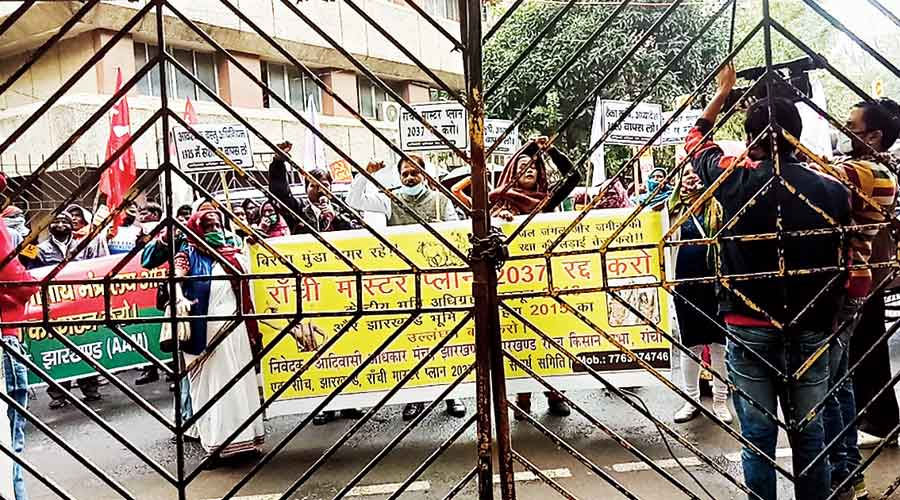 Activists shout slogans  outside the gate