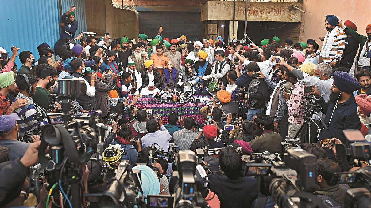Madhya Pradesh-based farmer leader Shiv Kumar Kakkaji, Bharatiya Kisan Union (BKU) spokesperson Rakesh Tikiat, and other farmer leaders address media after a meeting regarding the Centre's farm reform laws, near Singhu border in New Delhi, Wednesday, Dec. 9, 2020.