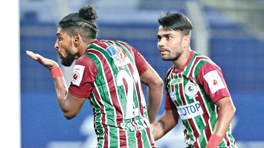 Roy Krishna celebrates his goal with Prabir Das on Wednesday.