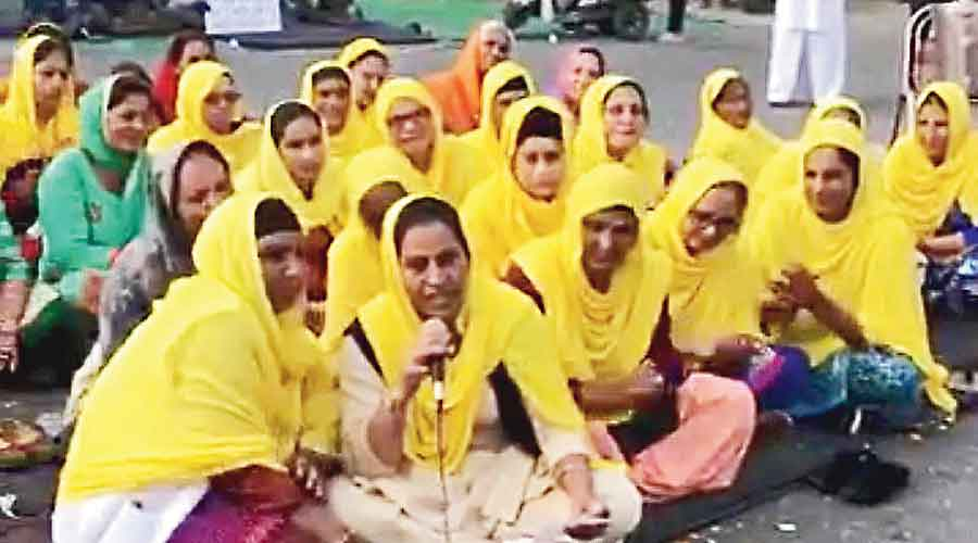 A still from a video circulating on social media shows protesters against the farm laws singing a song against Modi