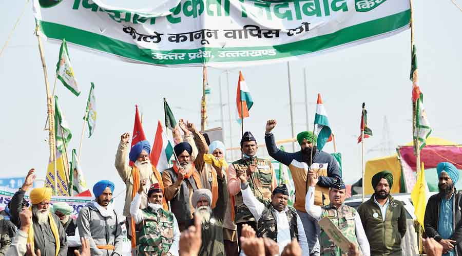 Ex-servicemen join the farmers' protest in New Delhi on Wednesday