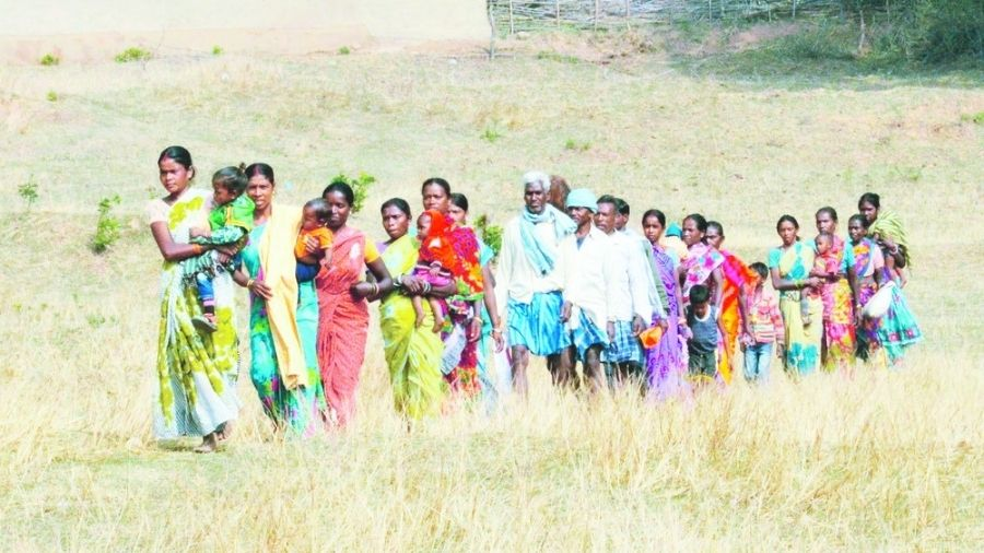 Residents of Suarkatwa village in Jhumra, under Pachmo panchayat area of Gomia block in Bokaro, march towards a polling booth during the first phase of rural elections in Jharkhand in November 2015.