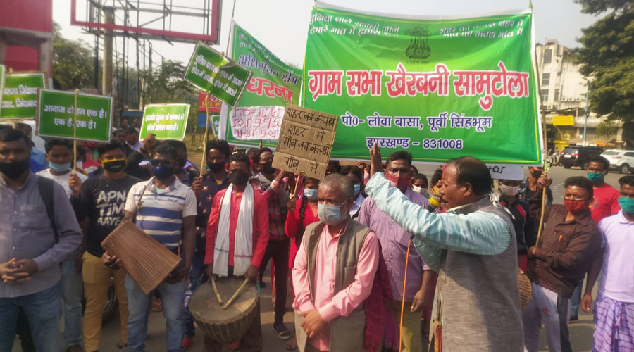 Protesters demonstrate with traditional drums against the construction of a waste management plant at the office of the Jamshedpur Notified Area Committee in Sakchi, Jamshedpur, on Friday.