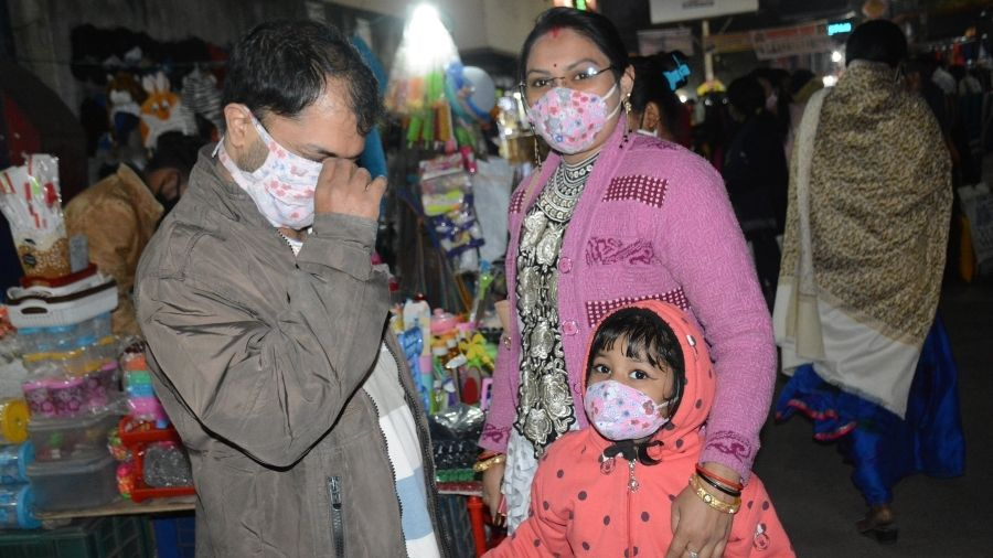 A family enjoys the winter at Sakchi in Jamshedpur on Saturday.