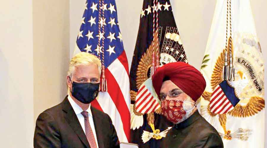India's ambassador to the US, Taranjit Singh Sandhu, accepts the 'Legion of Merit' award on behalf of the Prime Minister from the US National Security Advisor Robert O'Brien at the White House on Tuesday