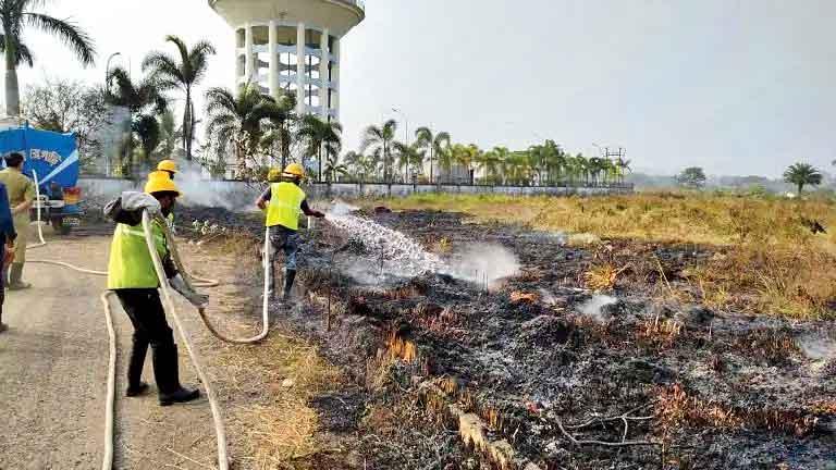 An NKDA team douses a fire on a New Town grassland