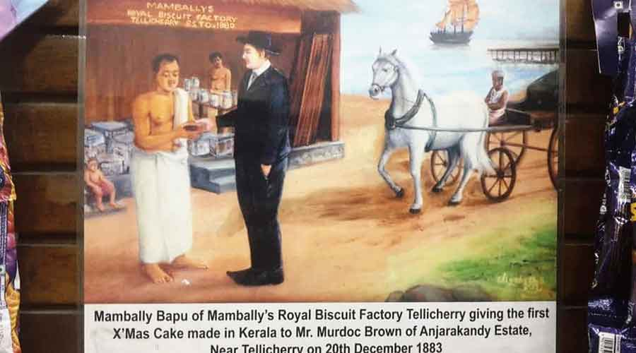 A painting of Mambally Bapu giving the first Christmas cake made in Kerala  to Murdoch Brown on December 20, 1883