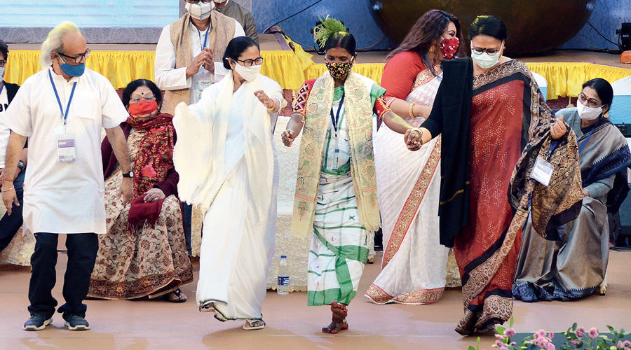 Mamata dances with artistes at the government programme in Calcutta on Wednesday.