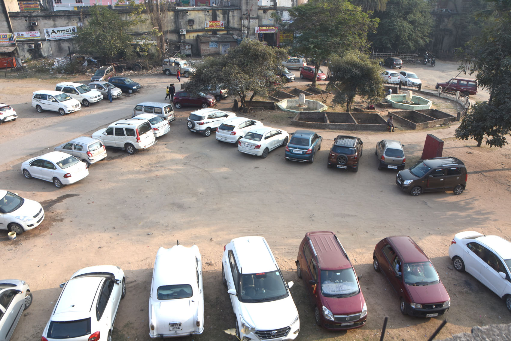 Vehicles parked at the unused space of the children's park at Hirapur, Dhanbad, on Friday.