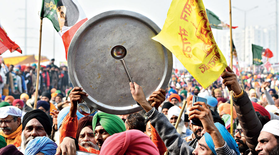 Farmers beat utensils at the Ghazipur border in New Delhi on Sunday as a symbolic attempt to drown out Prime Minister Narendra Modi's Mann ki Baat.