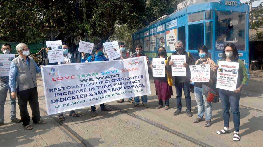 Members of the Calcutta Tram Users Association protest  at the Esplanade tram depot on Saturday.
