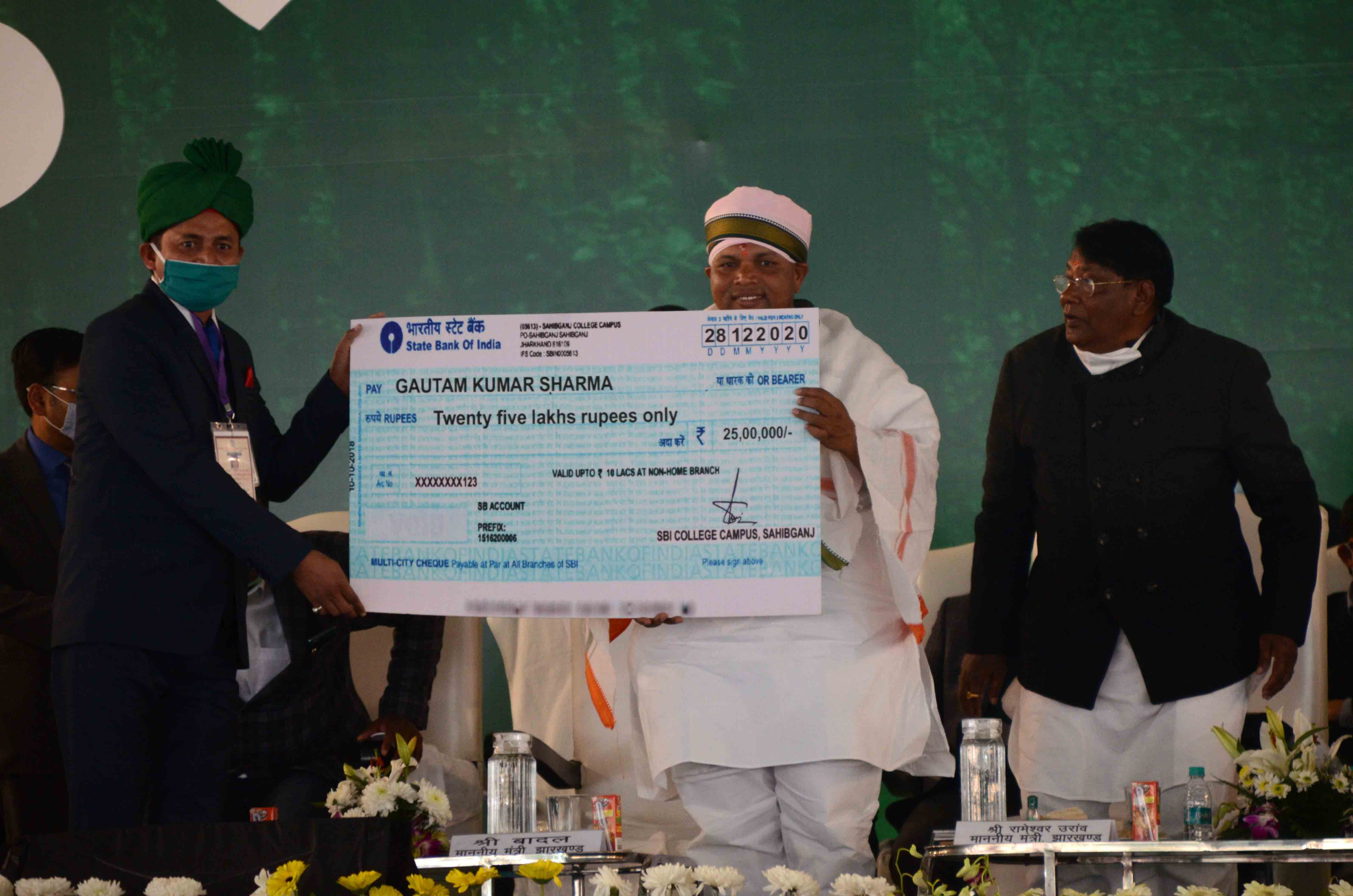 State agricultural minister Badal Patralekh distributing assets among beneficiaries of government schemes on the first anniversary of the Hemant Soren government at Morabadi Ground in Ranchi on Tuesday.