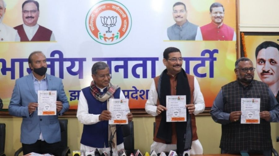 BJP legislature party leader Babaulal Marandi (left) with the state party chief Deepak Prakash during the release of the 'report card' of the government in Ranchi on Tuesday.