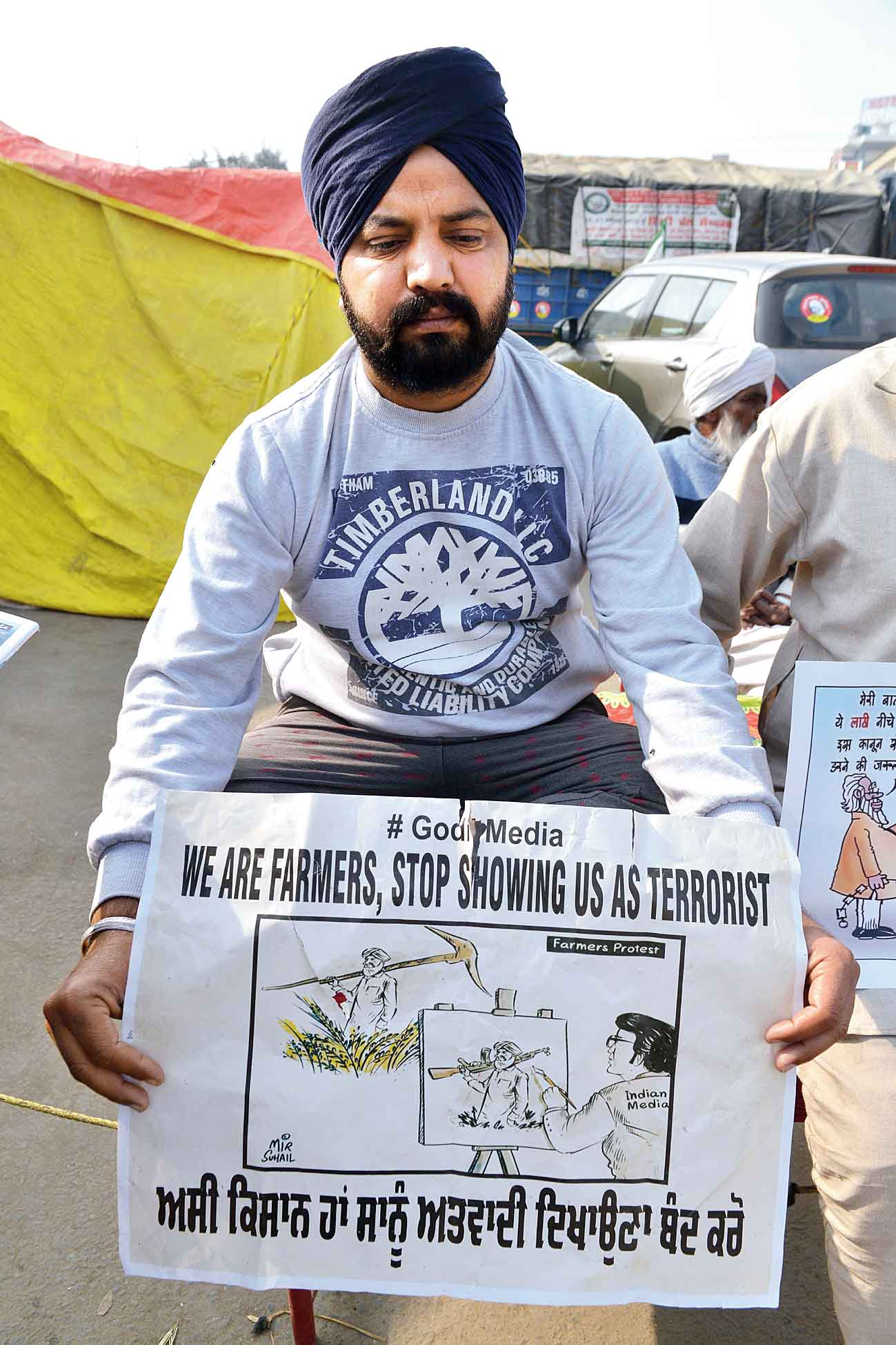 A farmer protests at the Singhu border