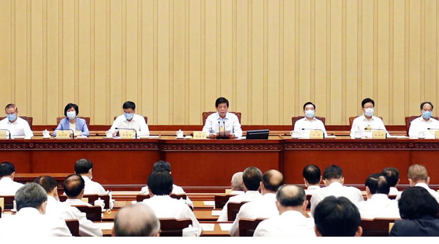 Li Zhanshu (center) presides over the closing meeting of the 13th NPC Standing Committee in Beijing on Tuesday