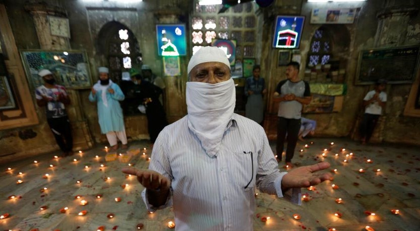 Muslims offer prayers for the protection against COVID-19 at Badshah no Hajiro or King's Mausoleum in Ahmedabad, on Tuesday