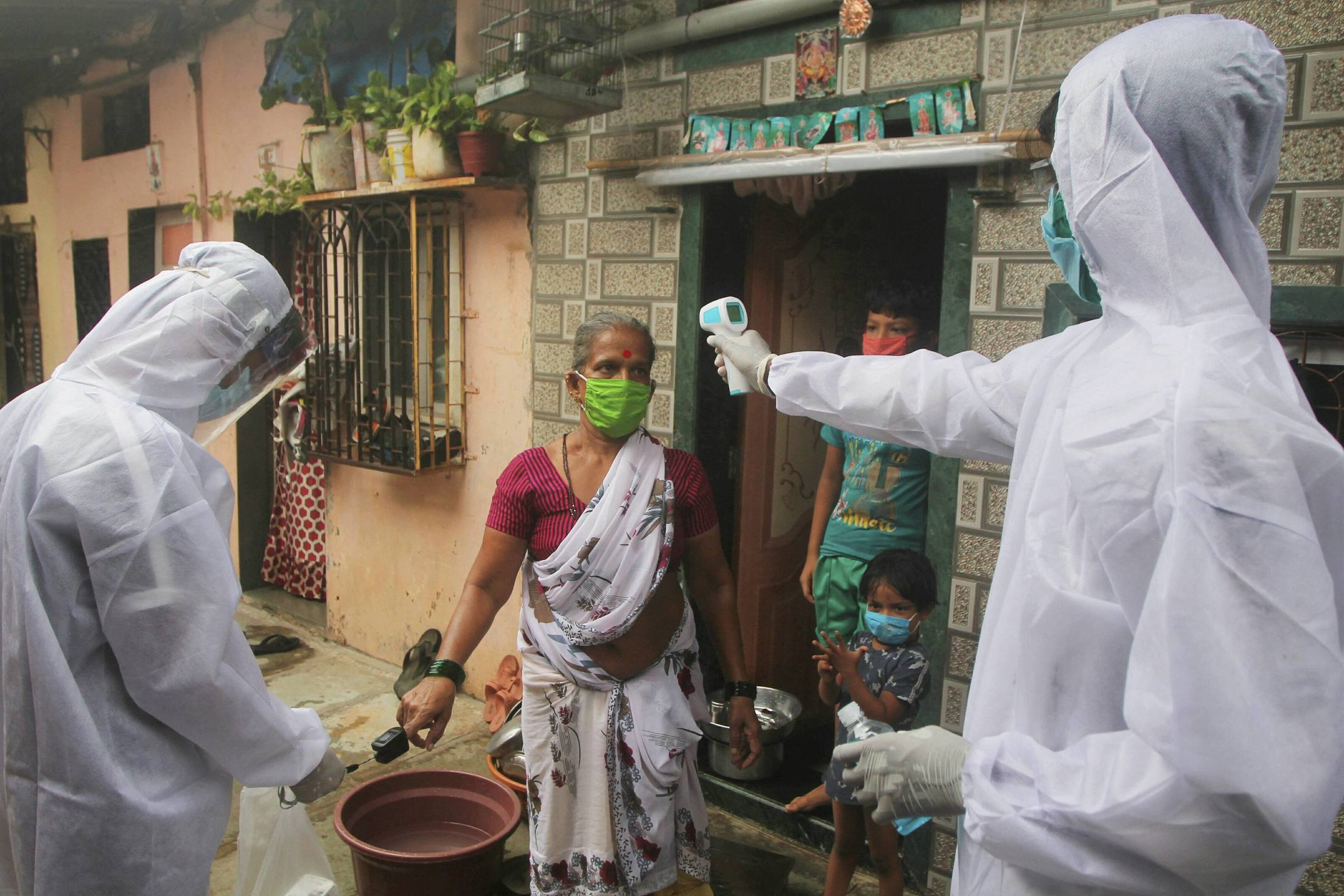 Health workers conduct door-to-door check-up at Shivaji Nagar slum for Covid-19 infection, in Mumbai, Wednesday, July 1, 2020.