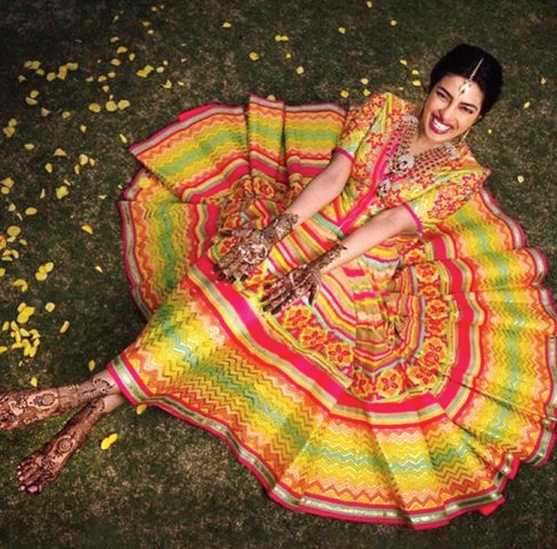 Priyanka Chopra in her mehndi ensemble designed by Abu Jani Sandeep Khosla for her wedding in 2018