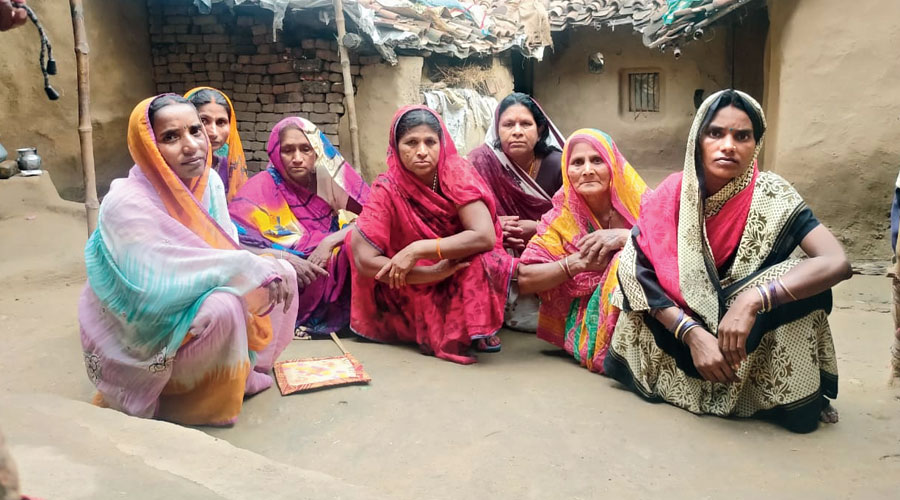 Relatives and villagers grieve for Sikandar Yadav in Bihar's Rohtas district on Tuesday.