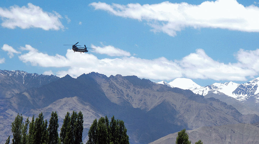 An Indian Army Chinook helicopter flies in Leh on Wednesday.