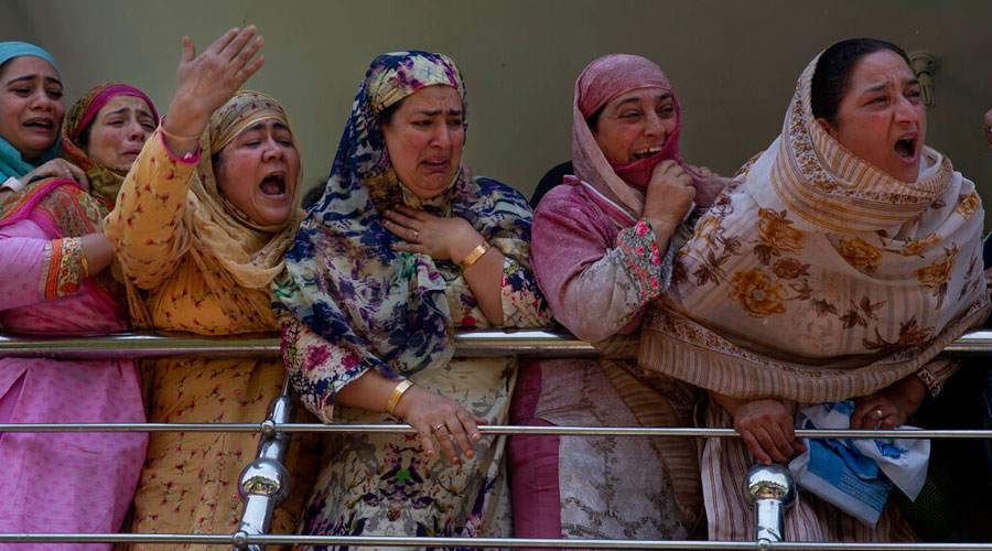 Relatives of Kashmiri civilian Bashir Ahmed Khan grieve as they watch his funeral on the outskirts of Srinagar on Wednesday.
